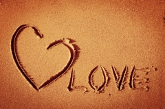 heart image at sand background