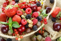Assorted summer berries (raspberries, strawberries, cherries, currants, gooseberries)