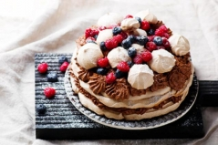meringuecake with chocolate mousse and berries. selective focus