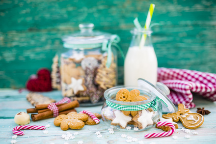 Delicious homemade Christmas cookies and milk in glass jar.