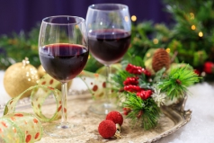 Red wine glasses and christmas balls on snow