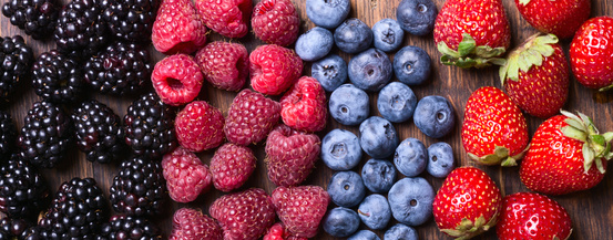 Berries (strawberry , raspberry , blueberries & blackberries ) on wooden background