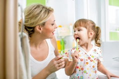 26269969 - mother and child daughter brushing teeth in bathroom